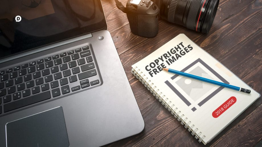 copyright free images on desk with laptop and camera